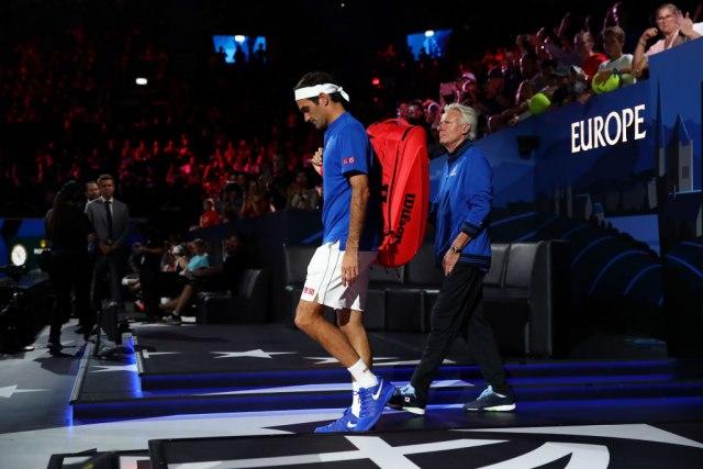 Federer pobijedio Iznera i smanjio zaostatak za Timom svijeta